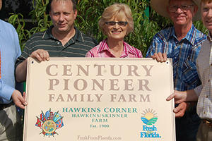Commissioner Putnam with Century Pioneer Family Farm owners Richard and Martha Sue Skinner
