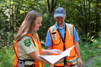 Photo:Forestry Staff looking at a publication